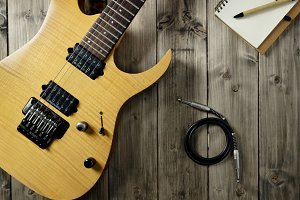 Guitar on Wood Top, Notepad & Cable