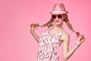 Fashion Funny girl Having Fun. Trendy pink Hat