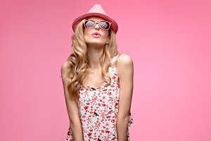 Fashion girl Having Fun Crazy Dance. Pink Hat