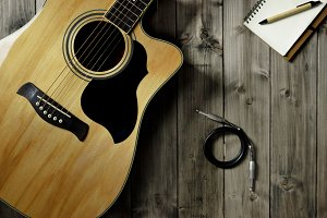 Acoustic Guitar on Wood Top & Cable
