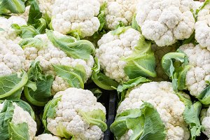 White heads of cauliflower at market