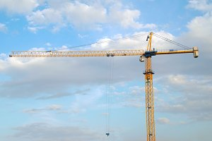 Building crane with the blue sky