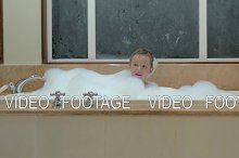 Playful child having bath with foam