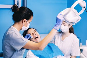 Dentists with a woman patient.