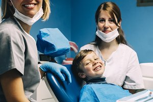 Dentists and child patient in clinic