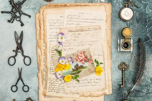 Vintage flat lay old letters pansy