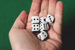 White dice on a hand. Isolated.