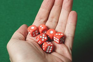 Red dice on a hand. Isolated.