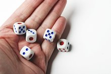 Hand throwing dice on white background. Isolated.