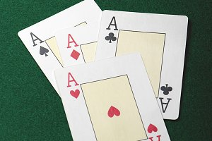Four aces on the green table of a casino. Poker.