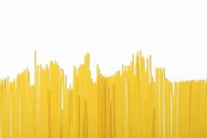 Spaghetti background on white background. Isolate. Horizontal shoot.