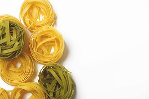 Background of spaghetti on white background. Italian pasta. Horizontal shoot.