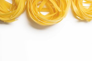 Background of spaghetti on white background. Italian pasta. Horizontal shoot. Copy space.