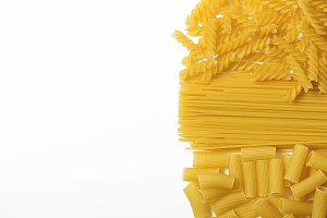 Background of macaroni and spaghetti. Isolated.
