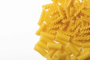Macaroni on white background. Copy space.