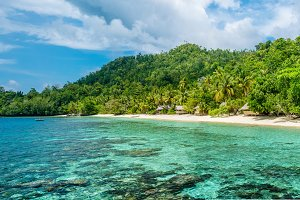 Lagoone and Bamboo Huts on the Beach, Coral Reef of Yananas Homestay Gam Island, West Papuan, Raja Ampat, Indonesia