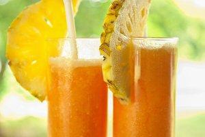 Fresh juice with pineapple slice