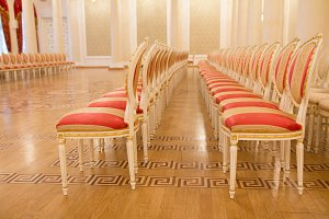 Red luxury chairs in the golden ballroom