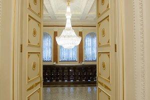Expensive luxury - crystal chandelier in golden ballroom