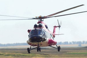 Modern emergency medicine helicopter take off at airfield
