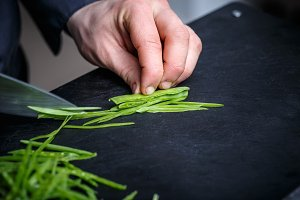 Chef cutting chives