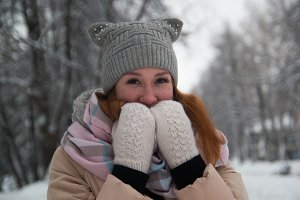 Young woman in winter park, close up