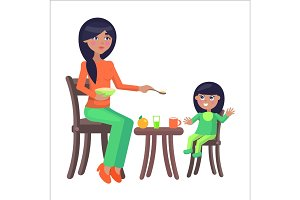 Mother Feeds her Little Daughter, Sitting at Table