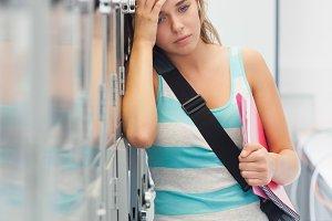Grimacing pretty student having a headache