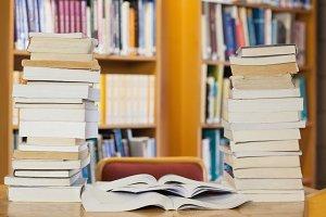 Stacks of books on desk
