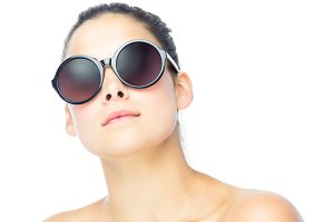 Young woman wearing big sunglasses