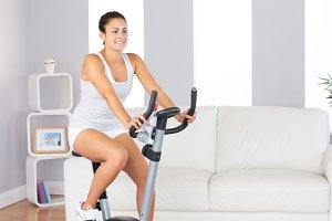 Beautiful fit woman training on an exercise bike