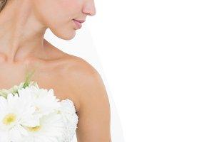 Attractive blonde bride holding a bouquet