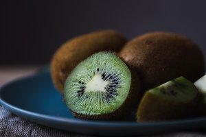 fresh kiwi on a blue plate