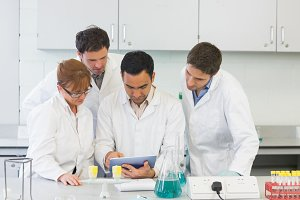 Serious scientists using tablet PC in the lab