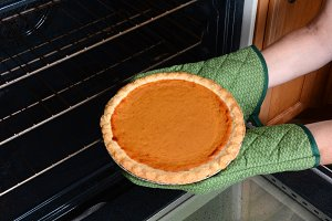 Taking Pumpkin Pie From Oven