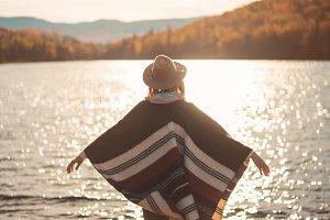 Tourist traveler enjoying sunset