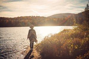 Hipster young girl enjoying sunset