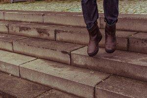 Man's feet walk outdoor