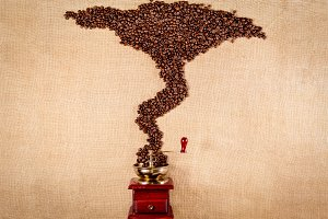 grinder of coffee with beans