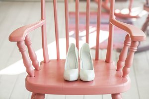 Womens wedding shoes on pink chair