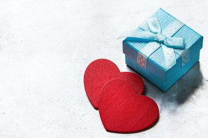 Valentines day love gift box with ribbon and red hearts