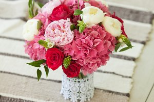 Beautiful wedding bouquet roses and peonies on thin carpet