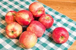 Honeycrisp apples on checked cloth
