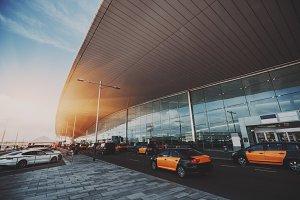 Multiple taxis near airport terminal