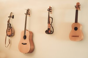 String Instruments Hanging on Wall