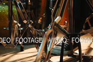 Drummer's foot in sneakers moving drum bass pedal, slider