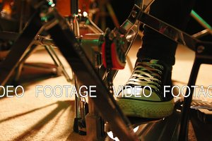 Drummer's foot in sneakers moving drum bass peda