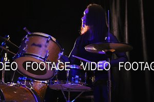 Emotional girl percussion drummer performing with drums, slider