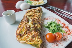 Breakfast - omelette with cherry tomato and greens