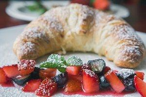Dessert in restaraunt - croissant with fruit